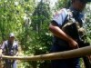Philippines militants threaten lives of three more hostages after beheading