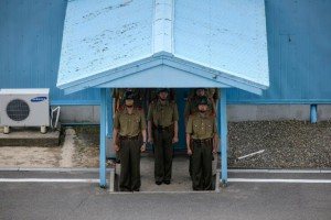 Korean People's Army soldiers stand beneath the entrance to a pavillion before the Military Demarcation Line (MDL) at the truce village of Panmunjom on the North Korean side of the Demilitarized Zone (DMZ) separating North and South Korea (AFP)