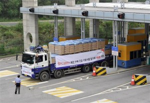 South Korean trucks carrying 500 tonnes of flour for North Korean flood victims drive through the South's inter-Korean transit gate in Paju, north of Seoul. (AFP)