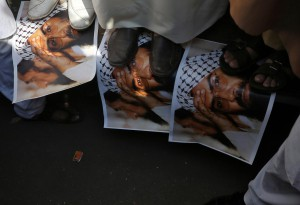 Demonstrators step on the posters of Maulana Masood Azhar, head of Pakistan-based militant group Jaish-e-Mohammad which claimed attack on a bus that killed 44 Central Reserve Police Force (CRPF) personnel in south Kashmir on Thursday, during a protest in Mumbai, India, February 15, 2019. (Reuters)