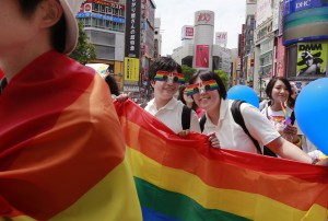 Participants smile as they march with a banner during the Tokyo Rainbow Pride parade celebrating the lesbian, gay, bisexual, and transgender (LGBT) community in Tokyo's Shibuya district (AP).