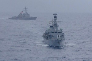 The USS McCampbell and the HMS Argyll manoeuvre during an exercise in the South China Sea in January. (Reuters)