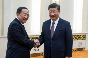 Chinese President Xi Jinping (right) meets North Korean Foreign Minister Ri Yong-ho at the Great Hall of the People in Beijing on Friday. (Reuters)