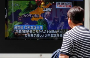 A man watches a television screen showing a news report on North Korea firing several short-range projectiles from its east coast, on a street in Tokyo, Japan May 4, 2019. (Reuters)