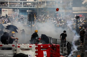 Protesters react to a tear gas during a demonstration against a proposed extradition bill in Hong Kong, China June 12, 2019. (Reuters)
