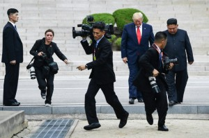 Photographers and camera operators did a lot of running, as well as a good deal of jostling and shouting as they tried to get into position for the impromptu DMZ date between Kim Jong Un and Donald Trump (AFP)