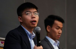 """Democracy activist Joshua Wong (left), with graduate student Brian Leung, attended a panel on """"Anti-Extradition Law Movement"""" in New York (AFP)"""