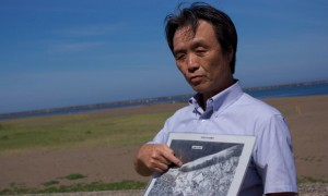 Kaoru Hasuike points at a map showing where he and his then girlfriend, Yukiko Okudo, were abducted by North Korean agents in 1978. (The Guardian )