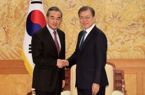 South Korean President Moon Jae-in, right, shakes hands with Chinese Foreign Minister Wang Yi during a meeting at the presidential Blue House in Seoul, South Korea, Thursday, Dec. 5, 2019. Wang arrived in South Korea on Wednesday for his first visit in four years amid efforts to patch up relations damaged by Seoul's decision to host a U.S. anti-missile system that Beijing perceives as a security threat. (AP)